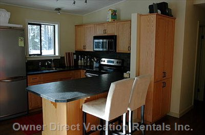 Newly Renovated Open Kitchen with all Necessary Appliances and Eating Bar.