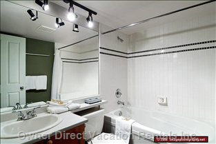 Two Full Bathrooms with Showers and a Jacuzzi Tub