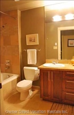Upstairs Bathroom has Double Sink Granite Vanity