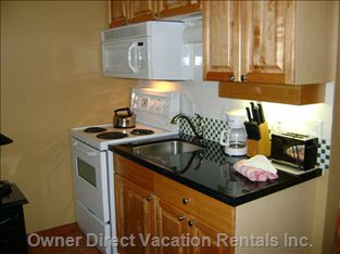 Microwave, Stove and Lots of Utencils, Cutlery and Pots/Pans