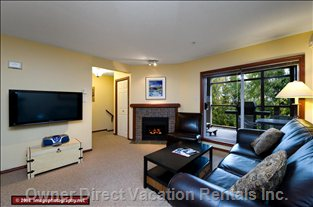 Living Room - this Home has a Large TV, Leather Couch and a Hot Tub off the Living Room.